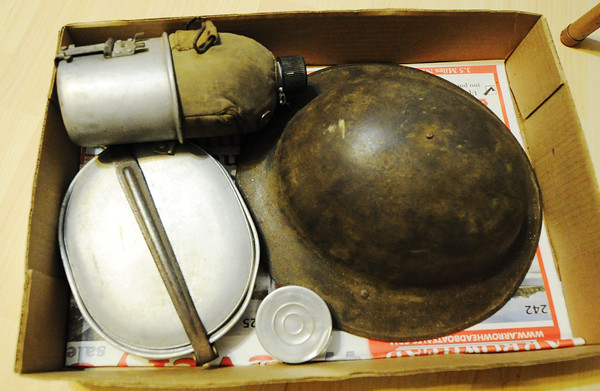 Globe/T. Rob Brown<br /> A box contains some of Walter Bridges' U.S. Government-issued military gear in the home of his son Charlie Bridges of Diamond Monday morning, Aug. 5, 2013.