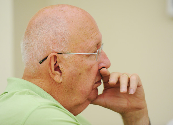 Dick Weber, of Joplin and chairman of the board for Southeast Kansas and Southwest Missouri for Mercy Health System, listens to usage ideas from residents for Joplin city land aquisitions on the current Mercy Health System property located near the intersection of 26th Street and McClelland Boulevard during an idea-gathering session with the community Thursday afternoon, Aug. 29, 2013, at Joplin City Hall.<br /> Globe | T. Rob Brown