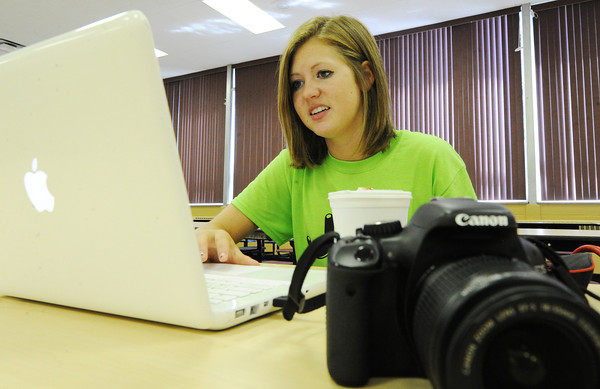 Globe/T. Rob Brown<br /> Joplin High School senior and yearbook editor Katie Earll works up photos for the book and for the Joplin Link Crew Facebook page during freshman orientation Thursday afternoon, Aug. 8, 2013, at the freshman and sophomore campus. The Joplin Link Crew are juniors and seniors who lead groups of incoming freshman during orientation.