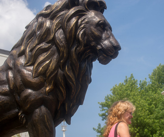 Globe/Roger Nomer<br /> Tamara Barnett, a Missouri Southern alumni, poses with the new Lion Icon statue at Missouri Southern on Monday.