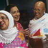Globe/Roger Nomer<br /> (from left) Julia Chowdhury, Joplin, Faiqa Kamran, Anderson, and Kathryn Wilson, Joplin, wait in line for food at the multi-denominational Iftar dinner on Saturday evening.