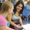 Globe/Roger Nomer<br /> Joplin High seniors Chrissy Miranda, right, and Chelsey Pippin talk during the first day of class at Joplin High School on Thursday.