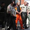 Bobby D. Bourne Jr. (center) is escorted by area deputies following his hearing Monday afternoon, Aug. 26, 2013, outside the Barton County Courthouse in Lamar. Bourne stands charged with the kidnapping, rape and murder of 12-year-old Adriaunna Horton of Golden City.<br /> Globe | T. Rob Brown