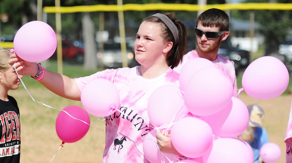 Chandra Sharp, 17, of Lamar, one of Adriaunna Horton's family members, hands out balloons to children to launch at the park Wednesday afternoon, Aug. 28, 2013, in Golden City.<br /> Globe | T. Rob Brown