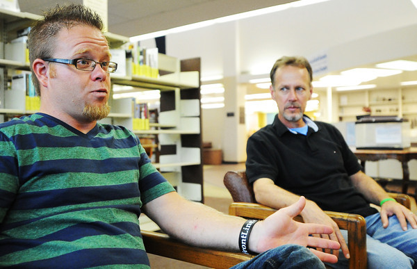 Globe/T. Rob Brown<br /> Donor Jake Jones (left) talks about the kidney transplant experience next to recipient Darrin Henry, both of Carl Junction, recently during a visit to the Joplin Public Library.
