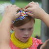 Globe/Roger Nomer<br /> Yvonne Perryman-Matthews, Jay, Okla., helps her daughter Mahayla, 7, with her headband at the Shawna Stovall Children's Back-To-School Pow-Wow at the Eastern Shawnee Pow-Wow grounds on Aug. 17.