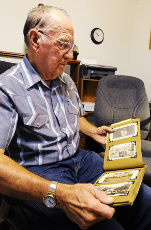 Globe/T. Rob Brown<br /> Charlie Bridges of Diamond looks through a World War I-era family photo album of his father Walter Bridges, who was a World War I veteran, Monday morning, Aug. 5, 2013.