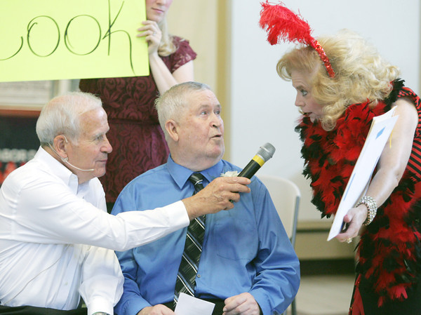 Globe/Roger Nomer<br /> Host Joe Hart and Susie Lundy interview Will Cook, center, about his artwork during the Little Balkans Senior King and Queen Pageant at Meadowbrook Mall on Friday.