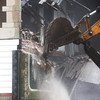 Globe/Roger Nomer<br /> Workers continue demolition of a building in the 900 block of Joplin's Main Street on Monday morning.