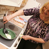 Globe/Roger Nomer<br /> Cheryle Finley tests the ceramic non-stick fry pan with an egg.