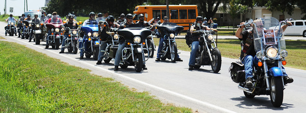 Covenant riders lead the funeral procession for Adriaunna Horton in order to keep the funeral path clear Wednesday afternoon, Aug. 28, 2013, following funeral services at Golden City High School.<br /> Globe | T. Rob Brown