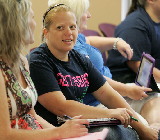 Globe/Roger Nomer<br /> Janet Parker, third grade teacher at Eastmorland Elementary, talks with fellow teachers during a meeting at the Joplin Administration building on Thursday.