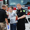 "Globe/T. Rob Brown<br /> Local emergency personnel participate in a bombing response exercise Friday morning, Aug. 2, 2013, at a parking lot near Missouri Southern State University's Fred G. Hughes stadium. The young man portraying one of the ""victims"" was initially believed to be the ""bomber."""