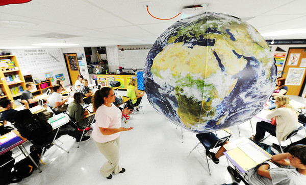 Globe/T. Rob Brown<br /> Joplin High School science teacher LaHeather Fisher educates under an inflatable planet Earth during Thursday morning's biology class, Aug. 22, 2013, at the freshman and sophomore campus at Memorial.