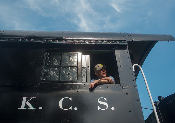 Globe/Roger Nomer<br /> Larry Spahn proudly looks out from the cab of the restored Kansas City Southern Steam Locomotive 1023 at the Heart of the Heartlands Museum Complex in Carona on Friday morning.