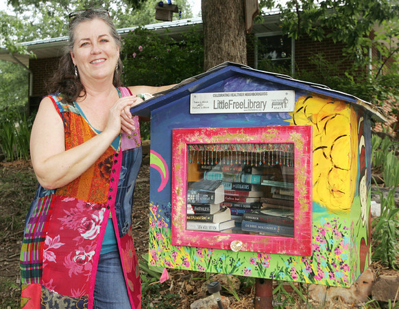 Globe/Roger Nomer<br /> Daria Claiborne shows her brightly-decorated Little Free Library located at 34th and Connecticut.