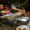 Globe/Roger Nomer<br /> Humza Rehman, 11, helps serve Umar and Humaira, 1, Firman, Joplin, during Saturday's multi-denominational Iftar dinner.