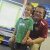 Globe/Roger Nomer<br /> Kindergartner Brayden Ferguson poses for a photo with Superintendent CJ Huff at Cecil Floyd on Thursday morning.  Huff continued his annual tradition of taking a photo with every kindergarten student in the district this year.