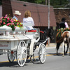 A horse-drawn funeral cart carries Adriaunna Horton's casket Wednesday afternoon, Aug. 28, 2013, through downtown Golden City to the cemetery.<br /> Globe | T. Rob Brown