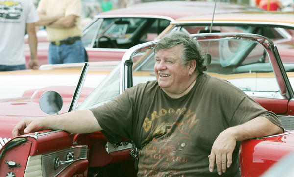 Globe/Roger Nomer<br /> Bud Day, Riverton, sits in his 1955 T-Bird during the classic car show in downtown Galena at the Route 66 International Festival on Friday.