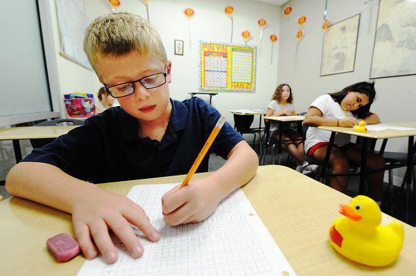 Globe/T. Rob Brown<br /> Evan D'Amour, Thomas Jefferson Independent Day School third grader from Joplin, writes in Chinese during the Chinese Camp at the school Monday afternoon, Aug. 5, 2013.