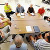 One of four discussion tables, lead by Gary Box (above center), project manager with Wallace-Bajjali, discusses possible locations for Joplin city land aquisitions on the current Mercy Health System property located near the intersection of 26th Street and McClelland Boulevard during an idea-gathering session with the community Thursday afternoon, Aug. 29, 2013, at Joplin City Hall. One of the proposed site uses is to build a new museum. Allen Shirley, president of the Friends of the Museum board, is right of Box.<br /> Globe | T. Rob Brown