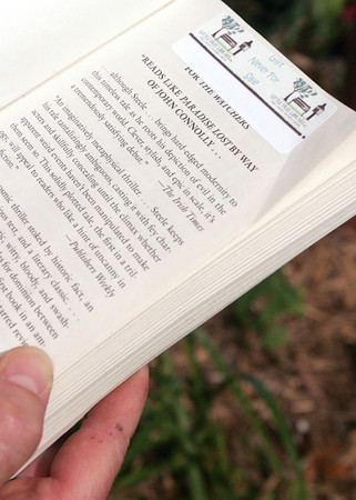 Globe/Roger Nomer<br /> Books available for lending at Daria Claiborne's Little Free Library are marked with a label.