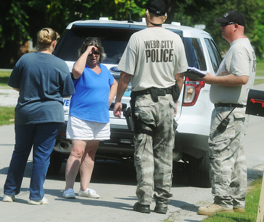 Globe/Roger Nomer<br /> Jenny Wilken, left, and Dixie Taylor talk with Webb City Police officers as the search continues for Adrianna Horton on Tuesday in Golden City.  Taylor said she knew Adrianna well as a volunteer at her school and as a baseball coach.