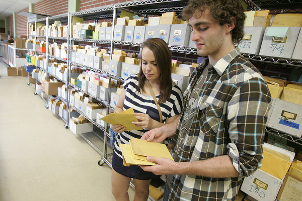 Globe/Roger Nomer<br /> Bree Adams and Aidan Shipley, Joplin, visit the Murwin Mosler archive to receive family negatives at the Joplin Museum Complex on Thursday afternoon.  Storing the negatives will contribute to the storage issues the museum is facing.
