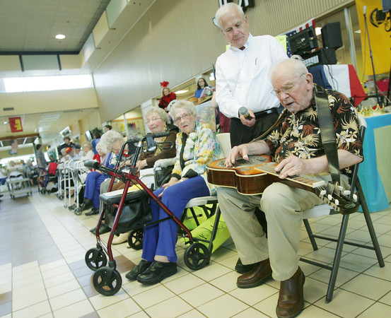 Globe/Roger Nomer<br /> Maurice Tuttle entertains the crowd with a song at the Little Balkans Senior King and Queen Pageant at Meadowbrook Mall on Friday.