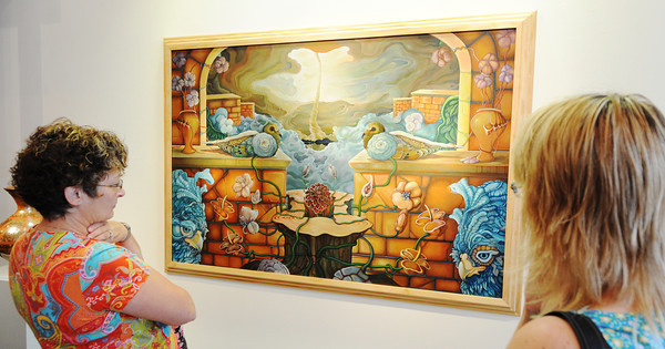 """Globe/T. Rob Brown<br /> Marilyn Wilson (left) of Bradford, Ill., and Beth Skinner of Diamond, look at a work titled """"Walls (hope, robust, revisited)"""" by local artist Andrew Batcheller Tuesday afternoon, Aug. 6,2013, at Spiva Center for the Arts. The oil on canvas, also subtitled """"Joplin two years later..."""" and created this year, is part of a display titled """"Birds in a Word"""" which continues through Sept. 8."""