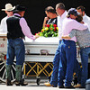 Pallbearers and family of Adriaunna Horton pause for an emotional moment before placing her casket onto a horse-drawn funeral cart Wednesday afternoon, Aug. 28, 2013, following funeral services at Golden City High School.<br /> Globe | T. Rob Brown