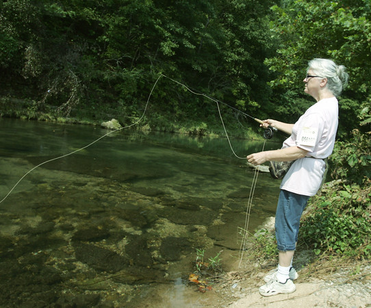 Globe/Roger Nomer<br /> Sophia Bickford, Cassville, fishes along the bank at Roaring River on Thursday.