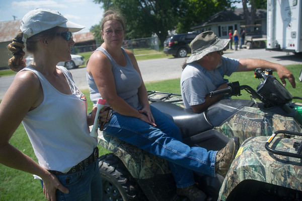Globe/Roger Nomer<br /> (from left) Tammie Smith, Jasper, Linda Shirk and Dale Boothe, both of Greenfield wait for an update on the search for Adrianna Horton.  The trio came to Golden City to volunteer for search efforts.