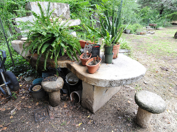 Globe/T. Rob Brown<br /> A concrete table and toadstools at the Boles home as seen recently.