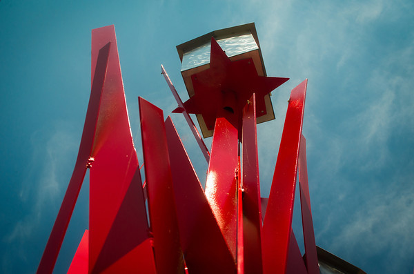 "Globe/Roger Nomer<br /> Jorge Leyva's ""The Reeds in Red With Silver"" pierces the summer blue sky at the Spiva Art Musuem.  The sculpture is in conjunction with Leyva and Brent Skinner's ""Essence of Unrelenting Elements"" at the museum, which runs through Sept. 8."