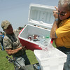 Globe/Roger Nomer<br /> Clyde Thomas, Nashville, left, and Calvin Pyle, Golden City, refill a cooler before the search resumes for Adriaunna Horton on Wednesday afternoon.