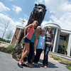 Globe/Roger Nomer<br /> Missouri Southern students (from left) Megan Holloway, Joplin senior, Marya Fenton, Webb City senior, Shelby Sullivan, Joplin senior, and April Holloway, Joplin freshman, pose with the Lion Icon statue in front of Billingsly Student Center on Monday.
