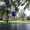 Globe/Roger Nomer<br /> Lance Weber, an Overland Park senior and member of Phi Sigma Capa, jumps for the organization's trampoline marathon at Pittsburg State on Wednesday morning.  The marathon raised money for Special Olympics.