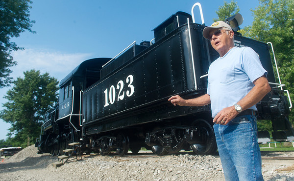 Globe/Roger Nomer<br /> Larry Spahn talks about the restoration process on the Kansas City Southern Steam Locomotive 1023 at the Heart of the Heartlands Museum Complex in Carona on Friday morning.
