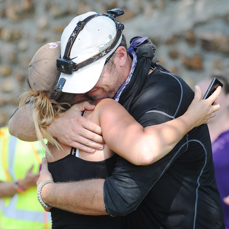 Globe/T. Rob Brown<br /> Search and rescue team members embrace back at the search headquarters in downtown Golden City Wednesday afternoon, Aug. 21, 2013, after the girl's body was discovered in a field.