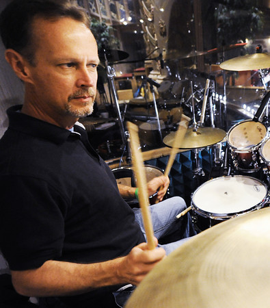 Globe/T. Rob Brown<br /> Darrin Henry, of Carl Junction, plays the drums during a recent choir practice at Central Christian Center.