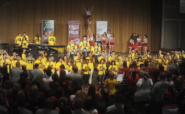 Globe/Roger Nomer<br /> The Joplin High School Marching Band and Spirit Squad perform for a packed house at College Heights Christian Church during Tuesday's Opening Day rally.