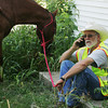 Globe/Roger Nomer<br /> Dan Scott, Golden City, rests in the shade with his horse Old Red during a break in the search for Adriaunna Horton on Wednesday.