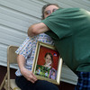 Globe/Roger Nomer<br /> Holding a photos of her missing granddaughter Adrianna, Velma Horton gets a hug from Robert Jones, a family friend from Lamar, on Tuesday afternoon.