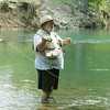 Globe/Roger Nomer<br /> Harry Kyle, Nevada, fly fishes at Roaring River on Thursday morning.