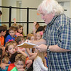 Keith Grimwood, of Trout Fishing in America jots down song ideas from children during a song writing workshop on Tuesday at Thomas Jefferson Independent Day School.<br /> Globe | Laurie Sisk
