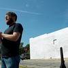 Globe/Roger Nomer<br /> East Town mural artist Kyle McKenzie talks on Wednesday before the ribbon cutting.