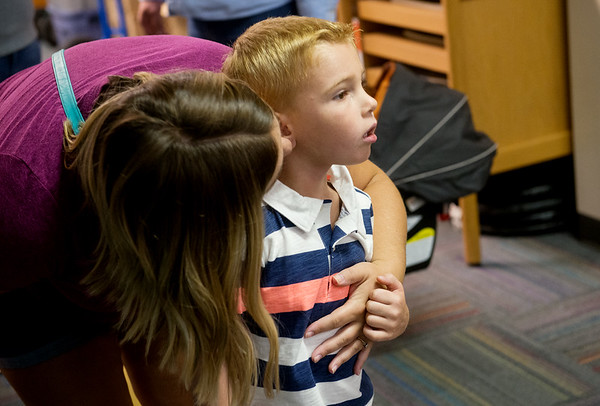 Globe/Roger Nomer<br /> Brenda Benefiel gives some last minute instructions to her son Pierceden on Thursday before his first day of kindergarten at McKinley Elementary.