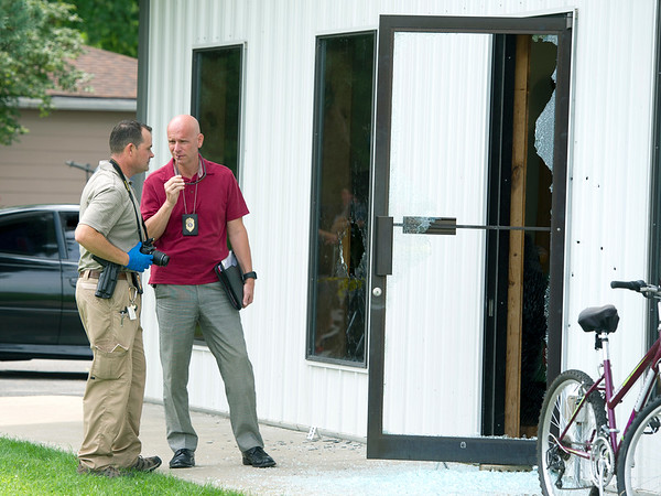 Investigators work the scene of a shooting on Monday morning at Prairie Mountain in Lockwood. Two employees of the company were injured during the shooting.<br /> Globe | Laurie Sisk
